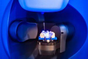 Dental laboratory. Production of dental crowns. Milling dental system with program control. Grinding and milling machine of dentures. Laboratory milling cutter for dental work. Dentistry.