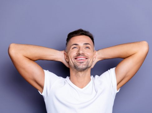Close up photo amazing he him his middle age macho look up empty, space perfect appearance teeth hands arms behind head overjoyed imagine flight wear casual white t-shirt isolated grey background